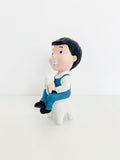 BOY WITH TOOTH FIGURINE