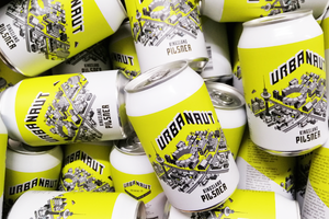 Many cans of Urbanaut Pilsner beer
