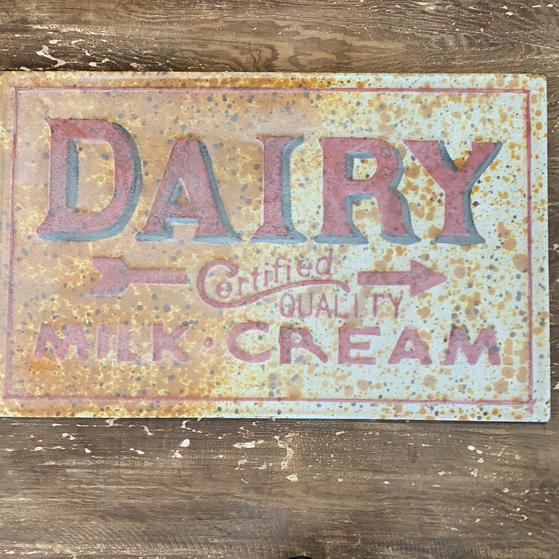 Rusted metal dairy sign