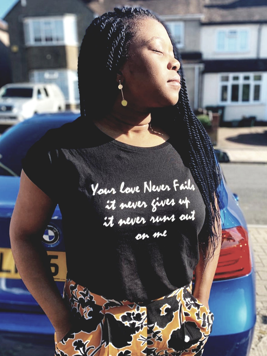 Women's LOVE NEVER FAILS Extended Shoulder Tee (Black)