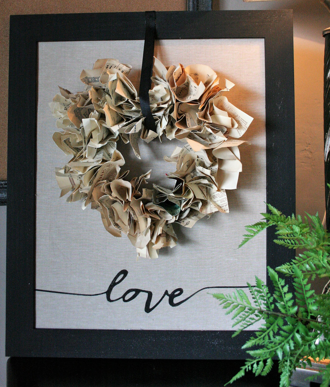 Linen framed sign with paper wreath