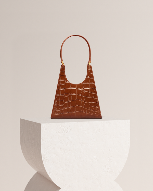 Chelsea brown leather tote bag front view on pedestal