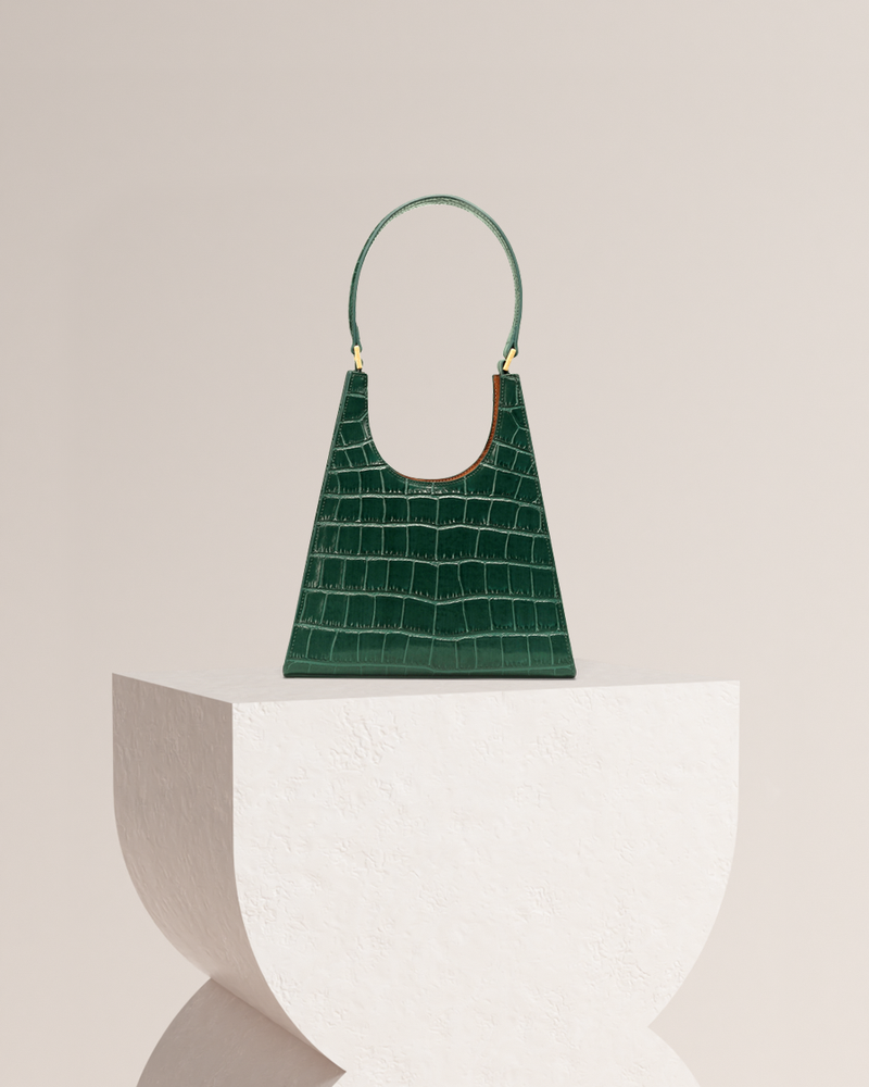 Chelsea green leather tote bag front view on pedestal