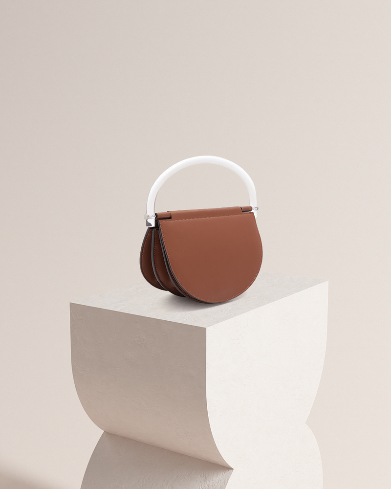 Estelle brown leather bag front and side view on pedestal