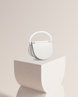 Estelle white leather bag front and side view on pedestal