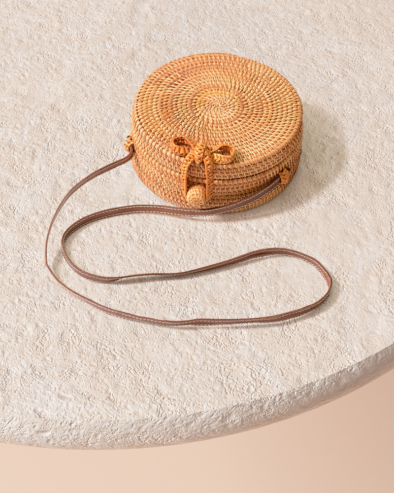 Bali natural rattan and straw bag on pedestal top detail view and leather shoulder strap