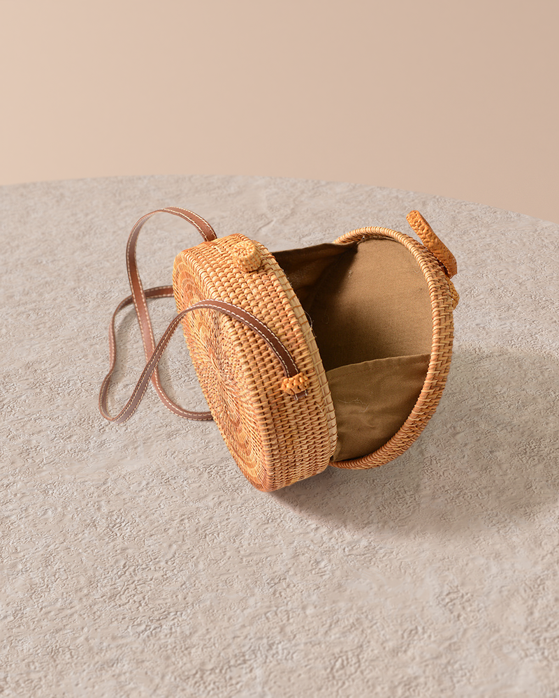 Bali natural rattan and straw bag on pedestal open top detail view