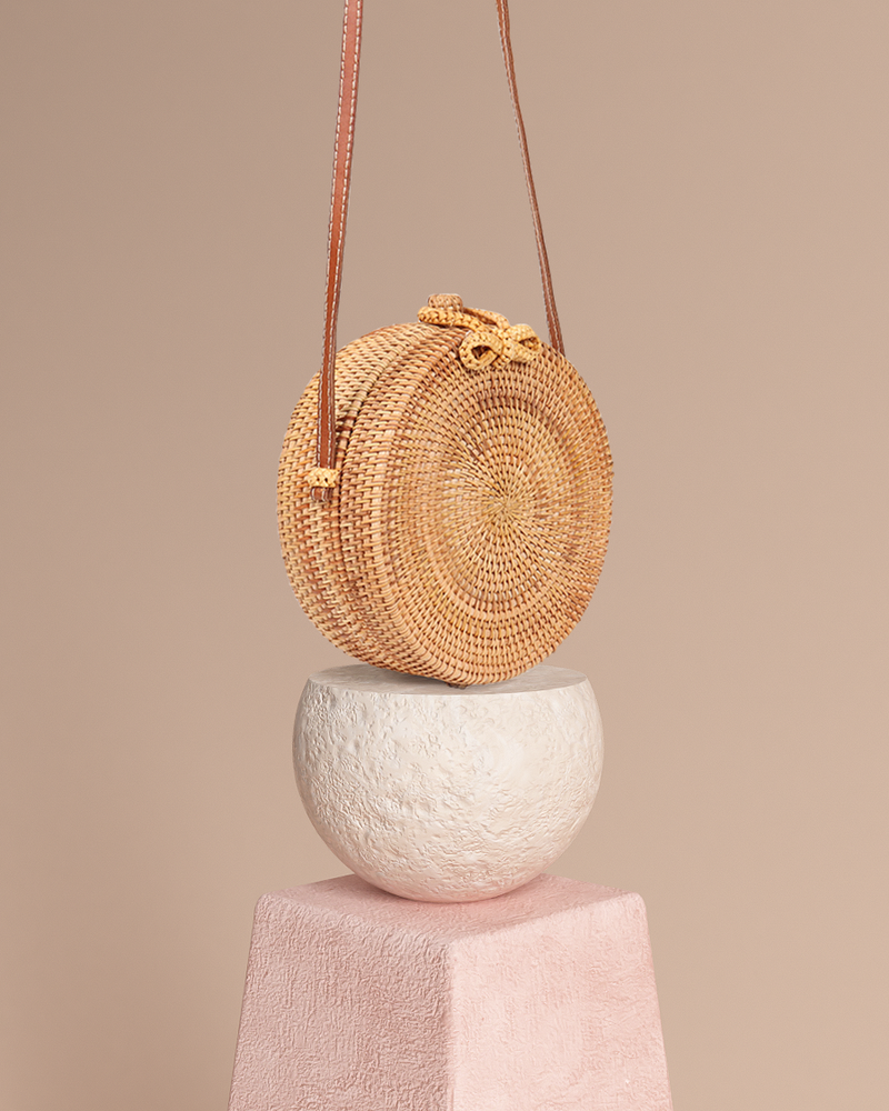 Bali natural rattan and straw bag on pedestal side view