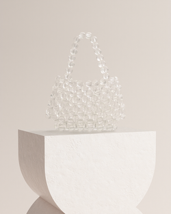 Ivy clear acrylic beads clutch front view on pedestal