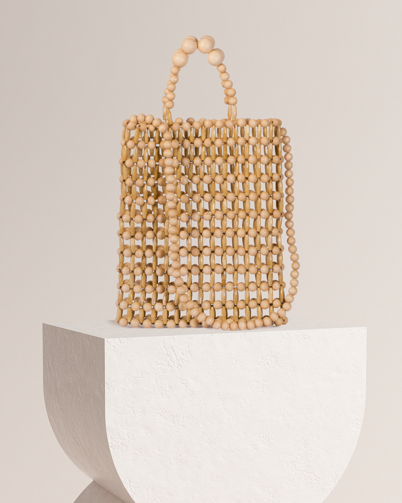 Cassey natural bamboo tote bag on pedestal front view