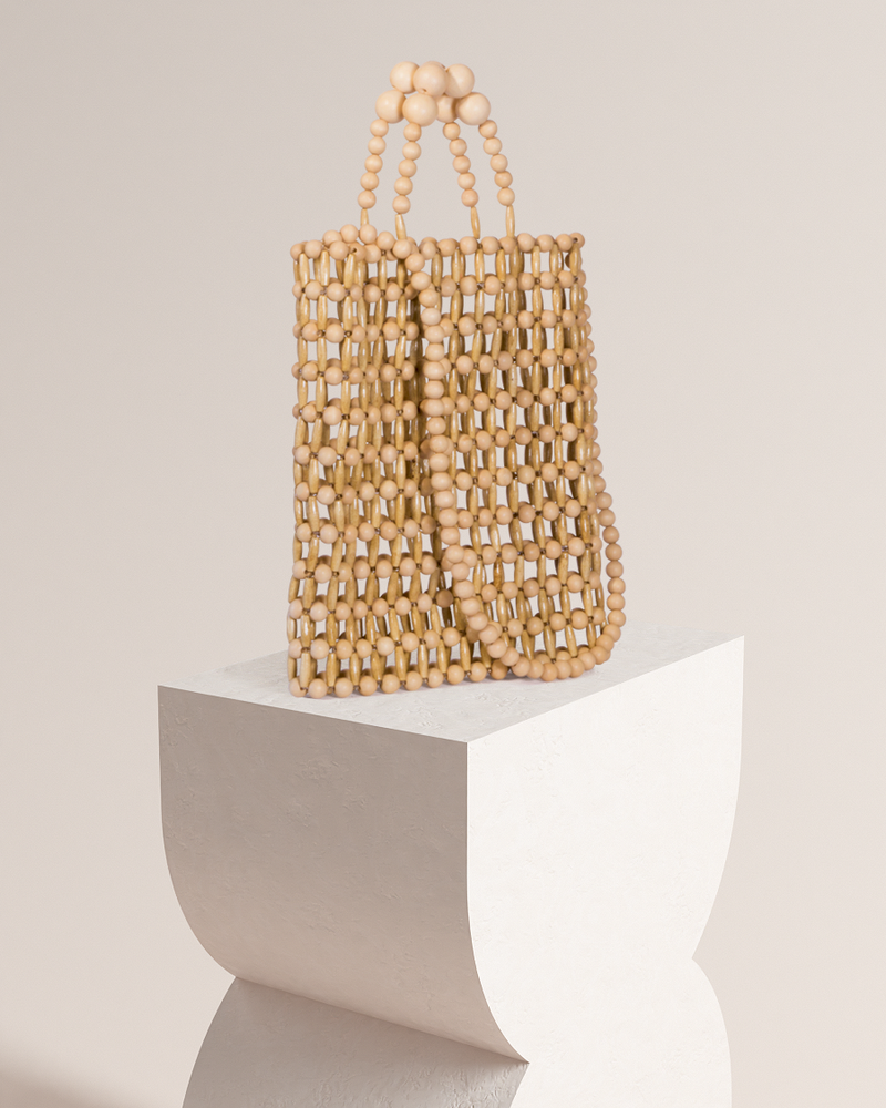 Cassey natural bamboo tote bag on pedestal side view