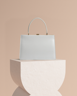 Diana white leather tote bag front view on pedestal