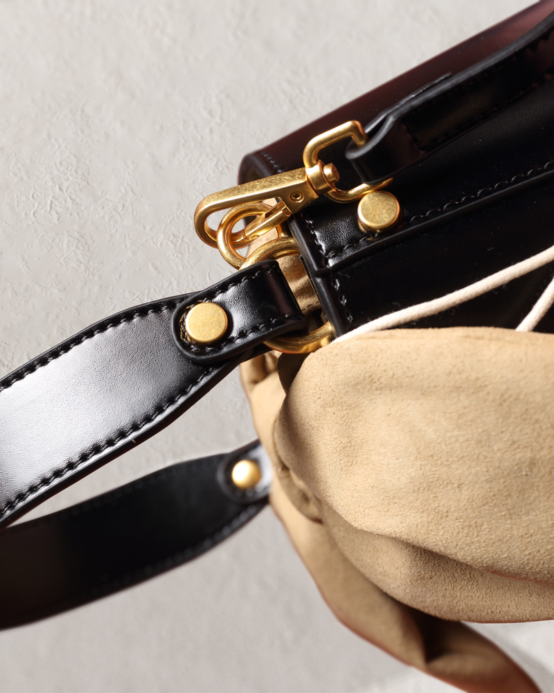 Esme black bucket bag top handle detail view