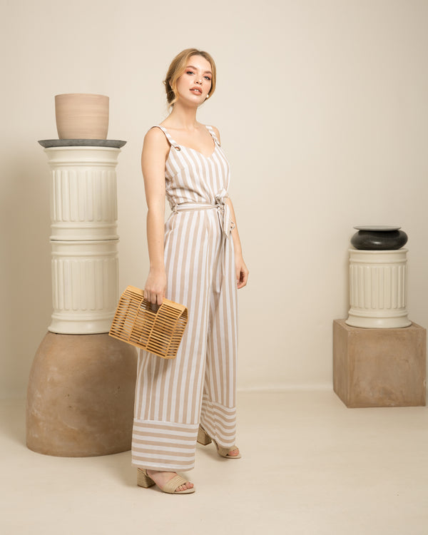 blonde woman in stripped dress holding Lara natural bamboo basket on set