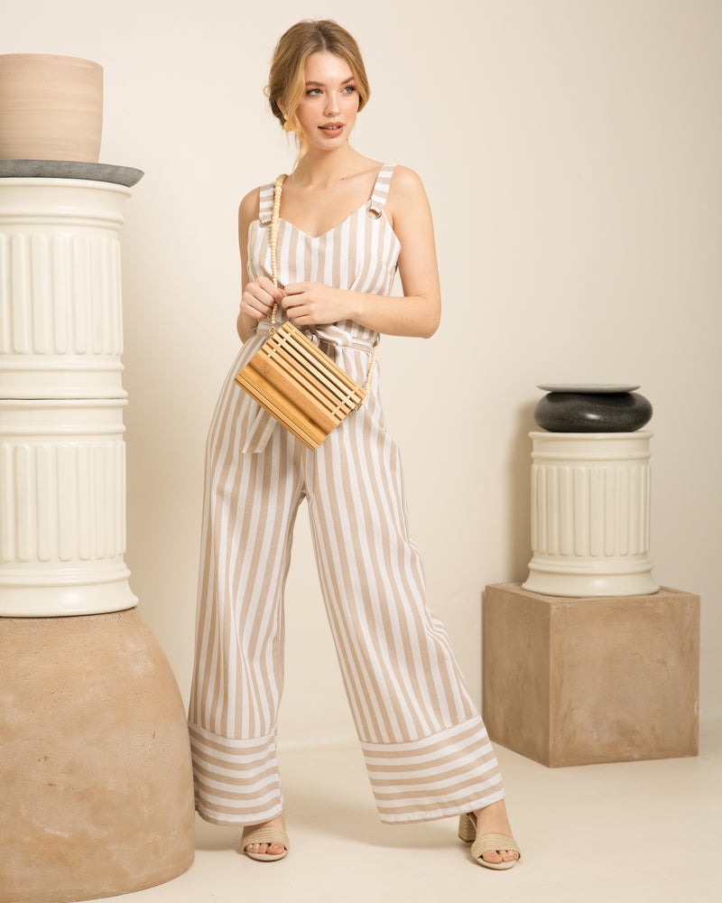 Blonde woman with stripped dress holding Amelie natural bamboo bag