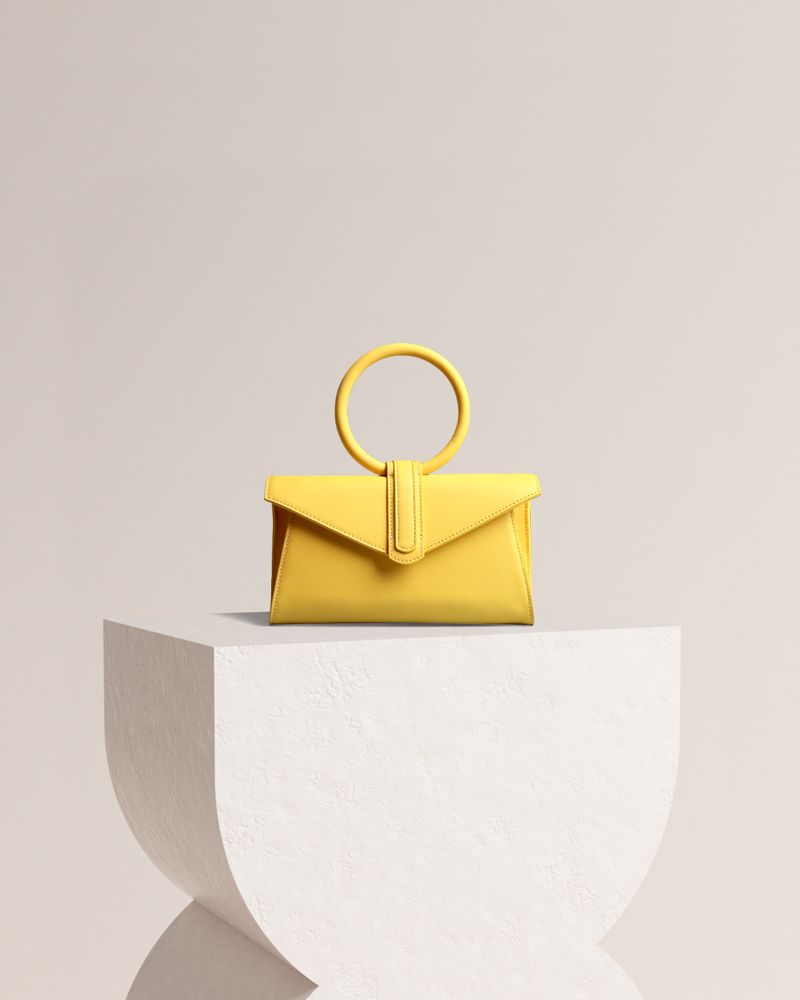 Simone leather bag in yellow front view on pedestal