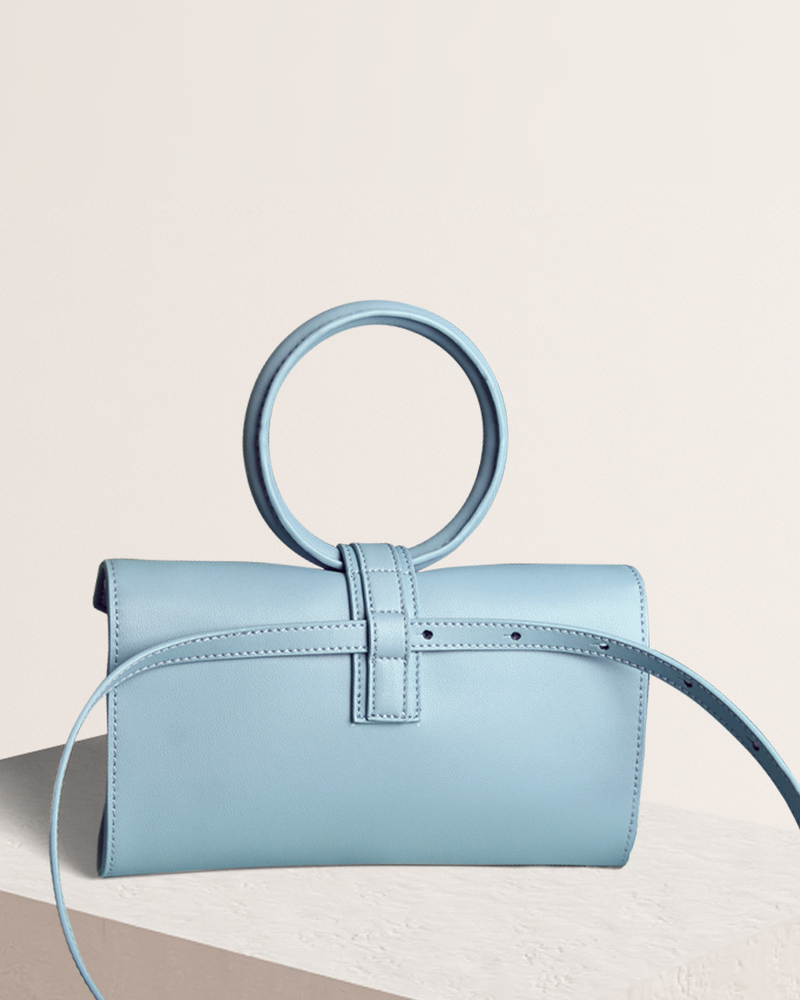 Simone leather bag waist strap in blue back view on pedestal