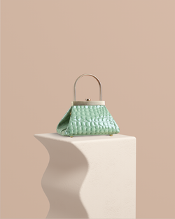 Lyra mint embossed leather bag front view on pedestal