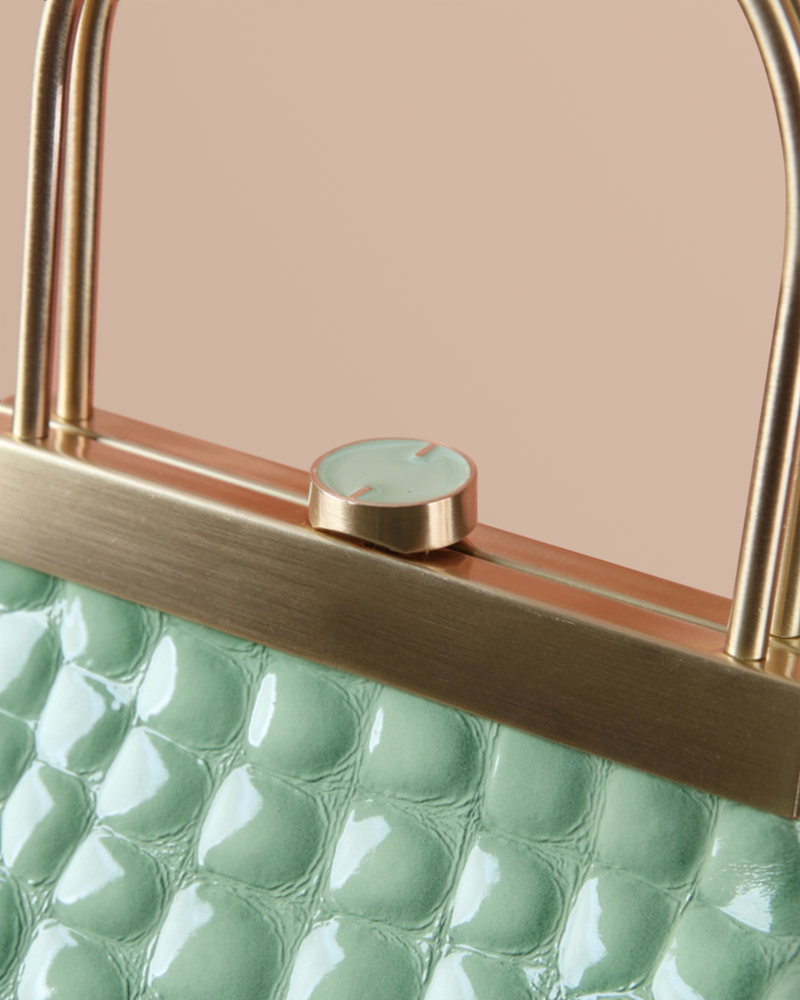 Lyra mint embossed leather bag top lock detail view