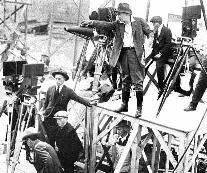 Director Cecil B. DeMille on film set.