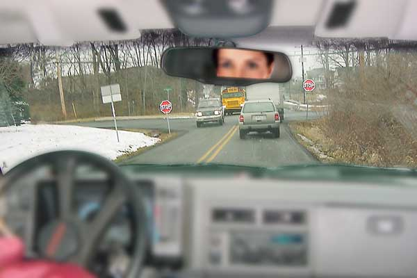 Person driving with no vision correct - car dashboard is blurry and distant objects are in focus