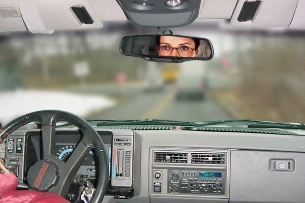 Person driving wearing normal reading lenses - car dashboard is in focus while far away objects are blurry