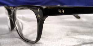 Detail view of Bull Markets glossy black rectangular eyeglasses