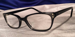 Side view of Bull Markets glossy black rectangular eyeglasses