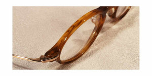 Top view of Capistranos tortoise shell and gold oval eyeglasses