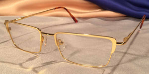 Side view of Crashers rectangular gold metal eyeglasses