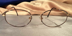 Front view of Directors gold metal and tortoiseshell eyeglasses