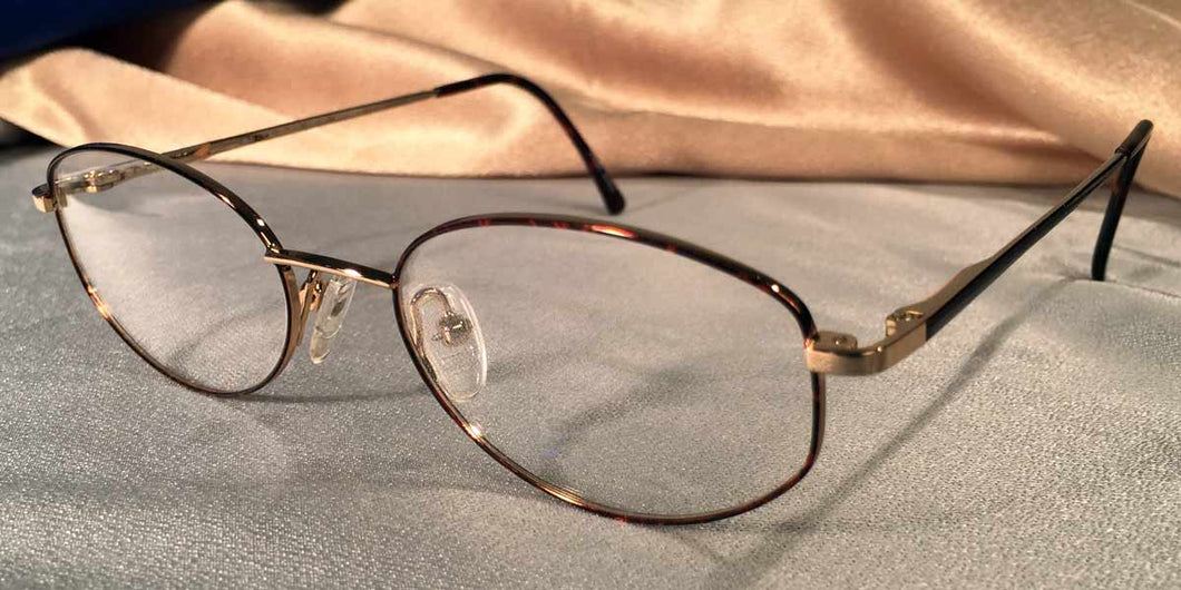 Side view of Directors gold metal and tortoiseshell eyeglasses