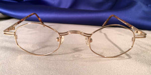 Duo-Bar Lunettes Angled Oval Gold Metal Eyeglass Frames Front View