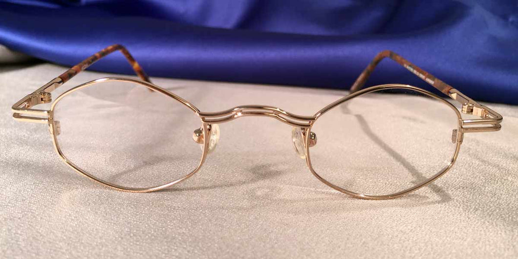 Front view of Duo-Bar Lunettes angled oval gold metal eyeglasses