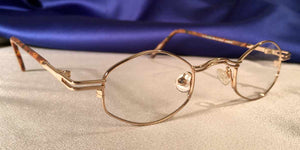 Corner view of Duo-Bar Lunettes angled oval gold metal eyeglasses