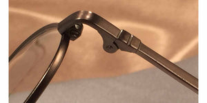 Detail view of Erudites gold pewter metal eyeglasses