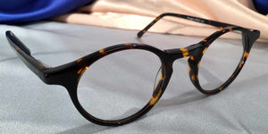 Side view of Governor's Poor Boys dark hue tortoiseshell eyeglasses