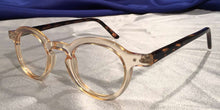 Side view of Hubbles tortoiseshell frames with clear wheat color rimmed eyeglasses