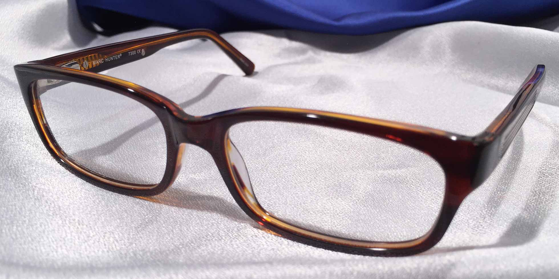 Front view of Persuaders amber brown rectangular eyeglasses