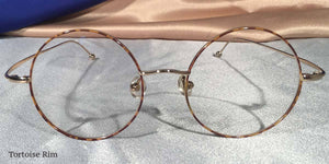 Front view of Signature Metal Rounds gold and tortoiseshell eyeglasses