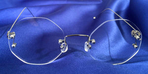 Signature Rimless Silver Eyeglass Frames with Octagon Lenses Front View