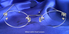 Front view of Signature Rimless silver eyeglasses with oval lenses