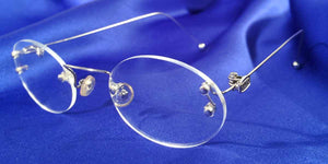 Side view of Signature Rimless silver eyeglasses with oval lenses
