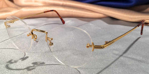 Side view of Traditionals Rimless gold metal eyeglasses with oval lenses