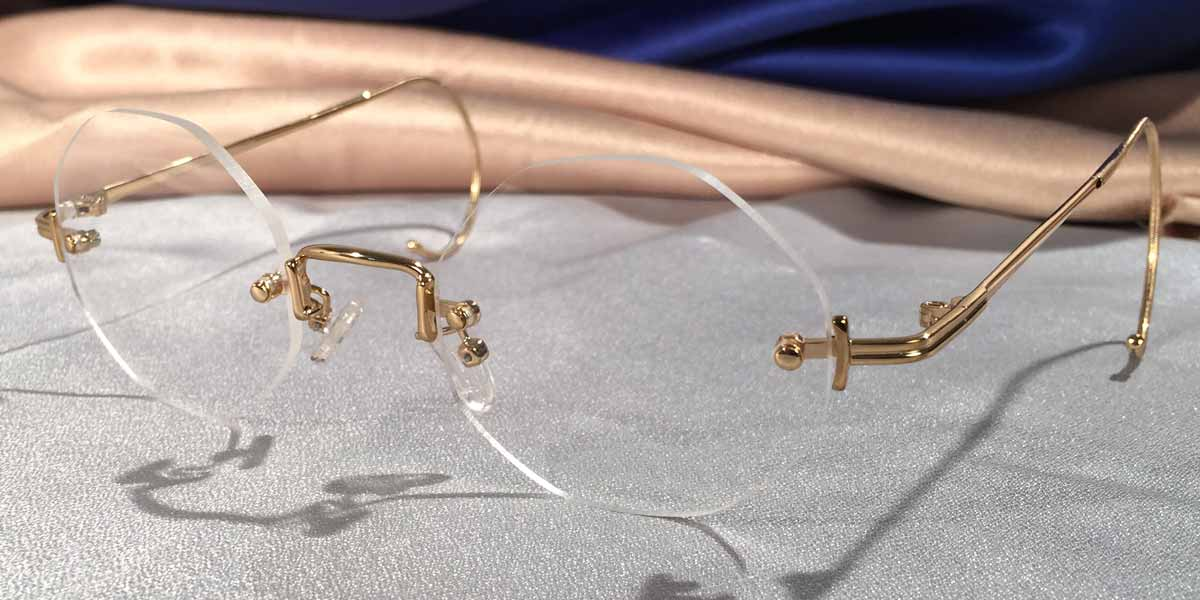 Side view of Tuxedo Cable Rimless gold metal eyeglasses with octagon lenses
