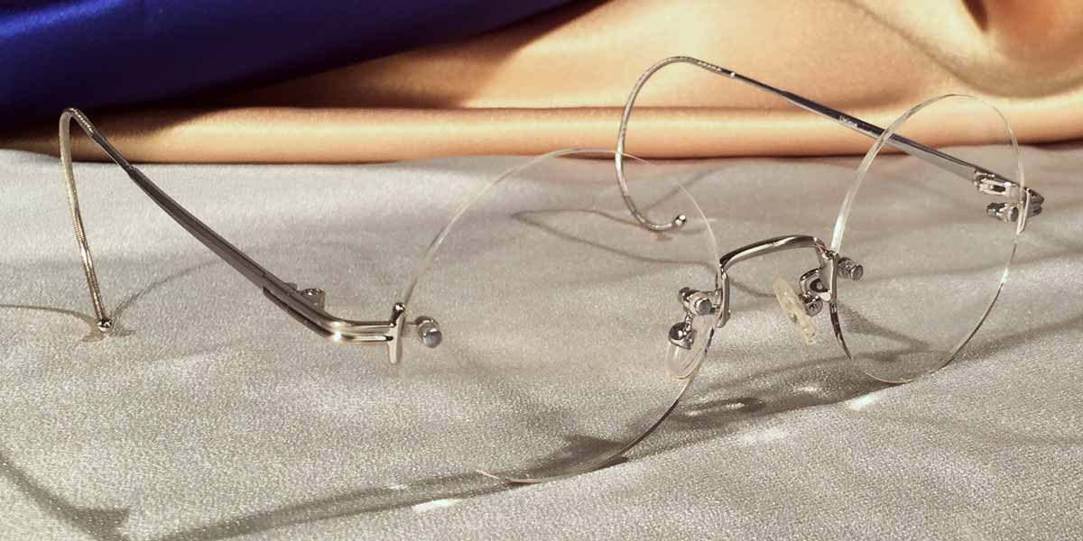 9d22713ab60 ... Tuxedo Cable Rimless Silver Eyeglass Frames Three Quarter View ...
