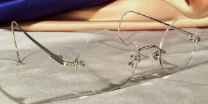 Side view of Tuxedo Cable Rimless silver metal eyeglasses with round lenses