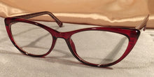 Corner view of Vampires cat-eye ruby red eyeglasses