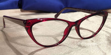 Side view of Vampires cat-eye ruby red eyeglasses