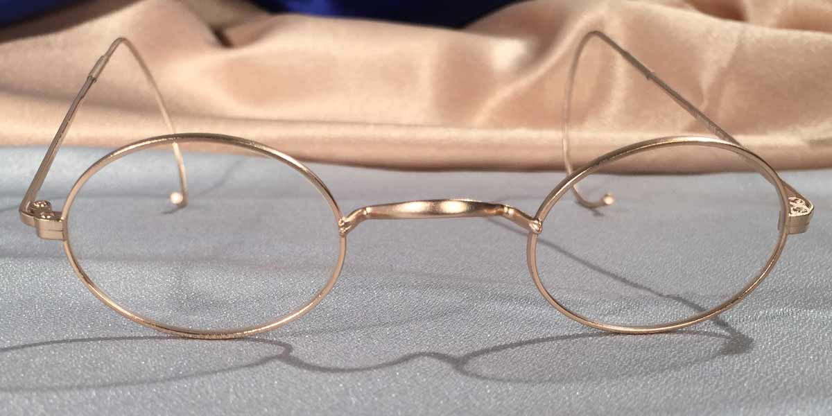 Front view of Windsors gold matte eyeglasses